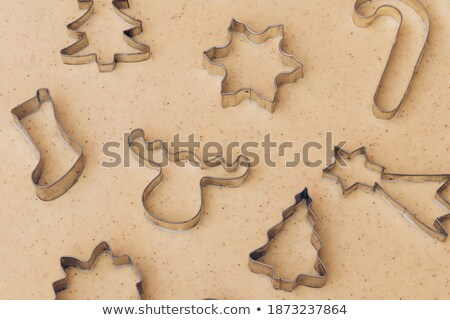 Christmas baking concept. Gingerbread dough with different cutter shapes Stock photo © dash