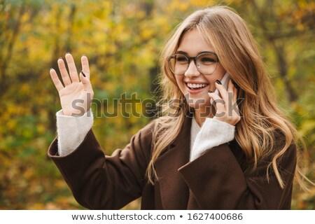 Gyönyörű fiatal nő diák park integet beszél Stock fotó © deandrobot