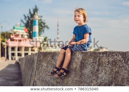Boy traveler on the background Dinh Cau lighthouse symbol of the island Phu Quoc, Vietnam. Phu Quoc  Stock photo © galitskaya