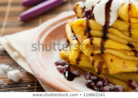 Sweet crepes with pomegranate Stock photo © YuliyaGontar
