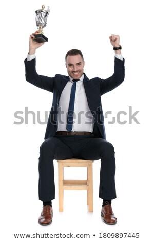 Sitzend eleganten Mann Sieg Trophäe Stock foto © feedough