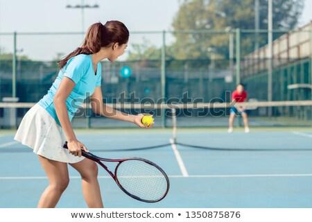 gyönyörű · ázsiai · teniszező · tart · ütő · labda - stock fotó © kzenon