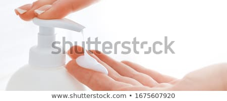 White bottle of shower gel lotion cream in hands Stock photo © manaemedia