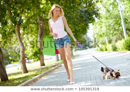 Young blond  woman with stroller going for a walk in a park  Stock photo © dashapetrenko
