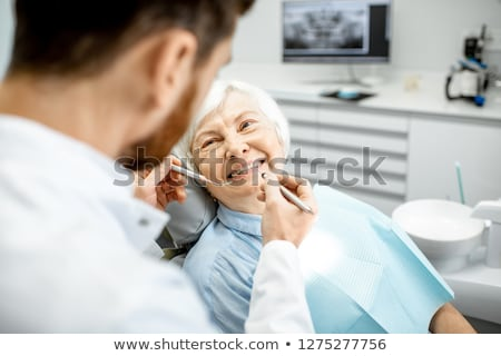 Kadın dişçi çalışma dişler implant doktor Stok fotoğraf © Elnur