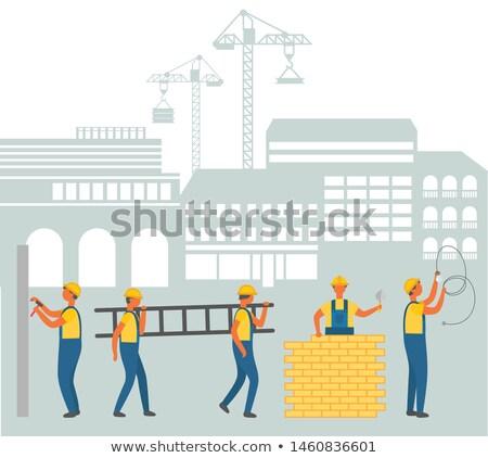Stock photo: Team of Workmen on Construction Area Cityscape