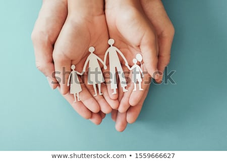 Hands Holding Paper With Cutout Hands Protecting House Stock photo © AndreyPopov