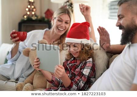 Apa lánygyermek videó hívás táblagép család Stock fotó © dolgachov