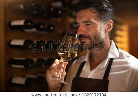 Winemaker in cellar making wine test. Stock photo © lichtmeister