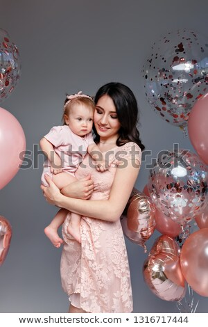 Nő rózsaszín ruha kicsi egyéves lánygyermek Stock fotó © ElenaBatkova