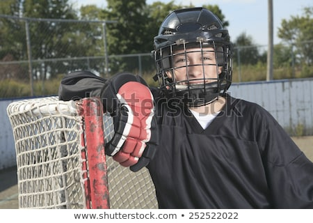 Portrait of hockey ball players play Stock photo © Lopolo