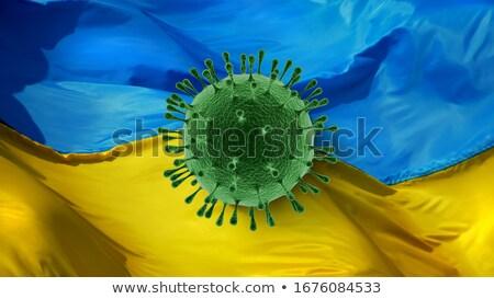 Stock photo: Model Of Coronavirus On The Background Of Ukrainian Flag