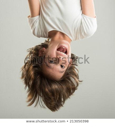 Upside down kid Stock photo © Lopolo