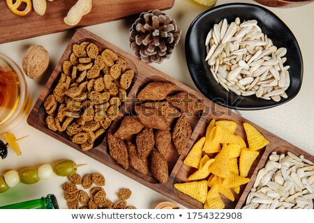 Stack of round organic crispy salty crackers on white.Top view Stock photo © DenisMArt