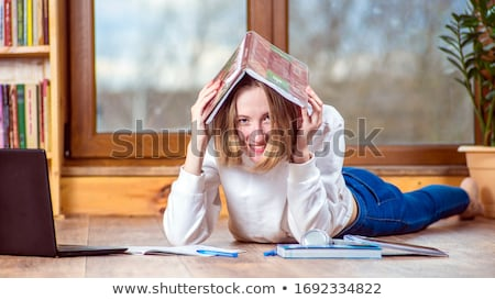 schoolgirl studying at home with a notebook and doing school homework stock photo © illia