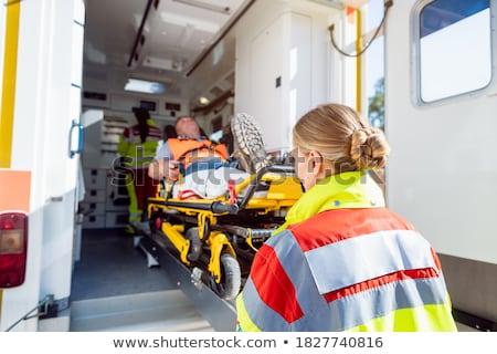 Mentők sebesült férfi mentő autó egyenruha Stock fotó © Kzenon