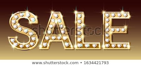 Golden heart inlaid with diamonds stock photo © Arsgera