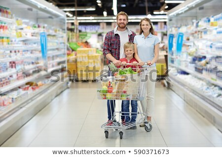 Stock photo: Father and mother with son in supermarket