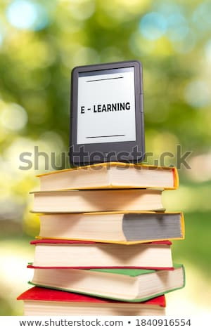 Electronic book reader laying outdoors Stock photo © AndreyKr