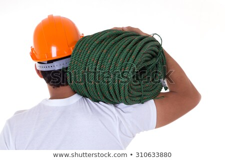 Muscular man carrying rope Stock photo © lovleah