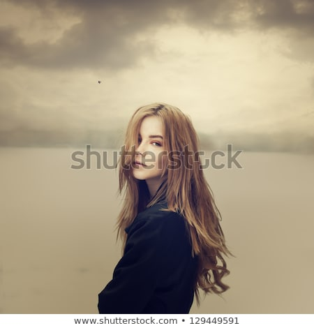 Teenage girls sitting in a field Stock photo © photography33