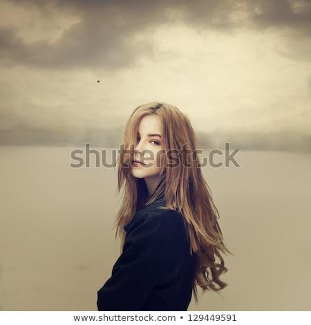 сидят области трава женщины волос Сток-фото © photography33