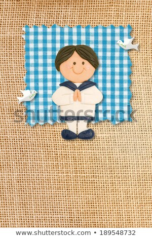 first holy communion invitation card rustic style funny brunette boy stock photo © marimorena