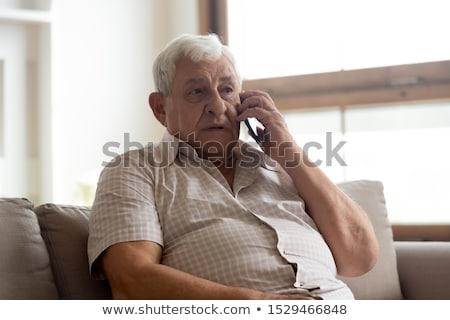 férfi · fogorvos · beszél · telefon · férfi · telefon - stock fotó © photography33