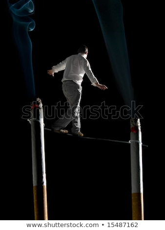 Walking the tightrope of smoking addiction Stock photo © antonprado