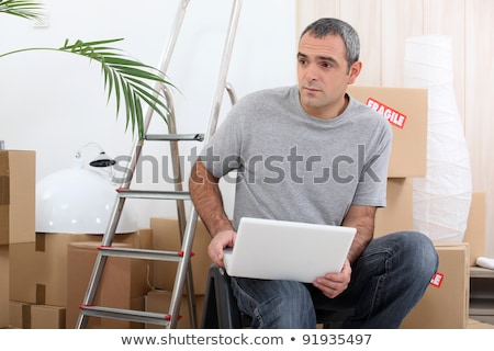 Man organizing logistics of house move Stock photo © photography33