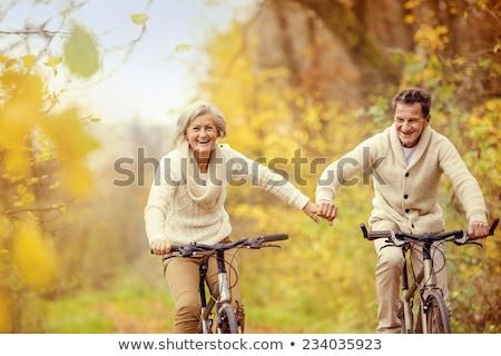Married couple enjoying bike ride Stock photo © photography33