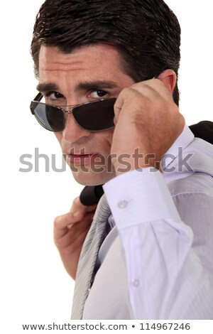 Businessman peering over his sunglasses Stock photo © photography33