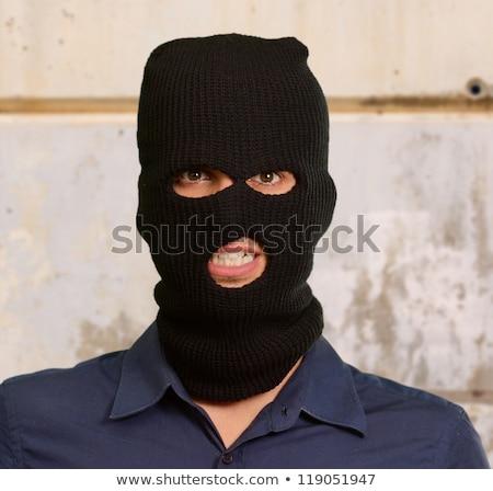 Terroriste portrait criminelle homme fusil noir Photo stock © tiero