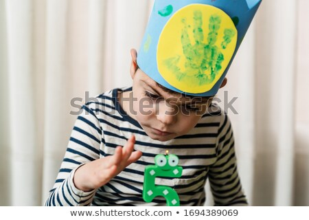 Disabled five year old boy blowing out birthday candles Stock photo © jarenwicklund