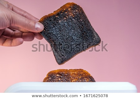 brindis · aislado · rebanada · alimentos · pan · negro - foto stock © stocksnapper