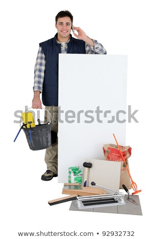 Tiler with a phone and a blank board stock photo © photography33