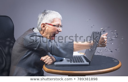 Woman about to punch her laptop Stock photo © photography33