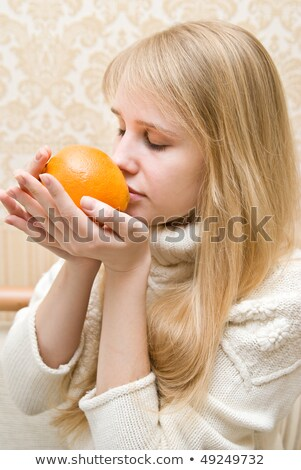 Woman sniffing orange Stock photo © photography33