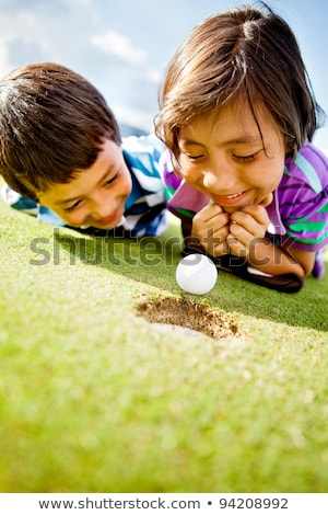 Menina jogador de golfe jogar golfe mulher verde Foto stock © goce