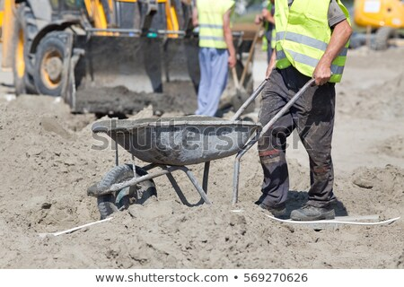 Laborer with wheelbarrow Stock photo © photography33