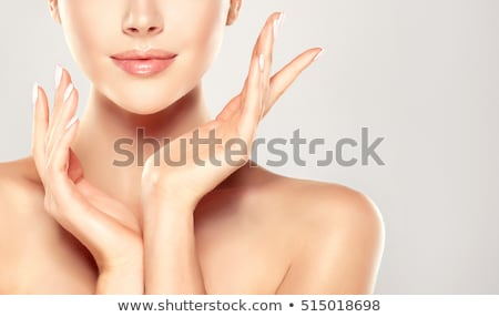 Smiling woman cleaning a bath with a sponge