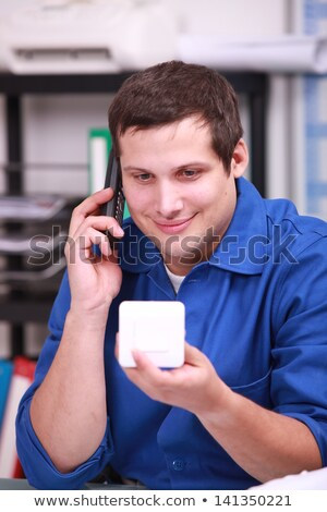 Plumber ordering new parts over the telephone Stock photo © photography33