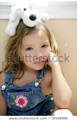 Happy toddler girl with toy dog over head stock photo © lunamarina