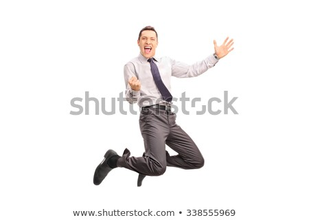 businessman jumping at studio full on white stock photo © lunamarina