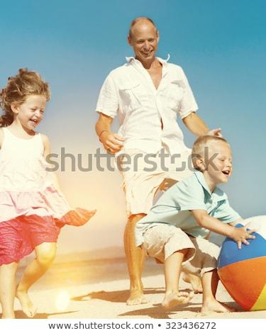 happy little child kid boy  playing beachball on beach in summer  Stock photo © juniart