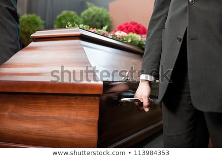 Funeral with casket carried by coffin bearer Stock photo © Kzenon