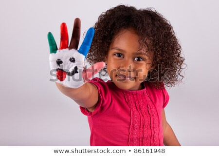 cute little girl with finger paint looking up Stock photo © gewoldi
