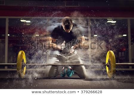 gym chalk magnesium carbonate hands clap man stock photo © lunamarina
