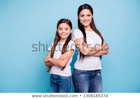 Young positive brunette girl with long hair wearing t-shirt and jeans Stock photo © Nejron