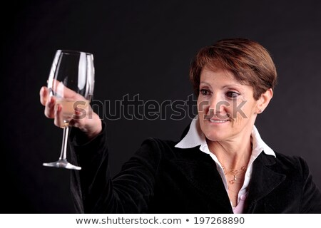 pretty old woman rising up a glass of wine (focus face) Stock photo © Giulio_Fornasar